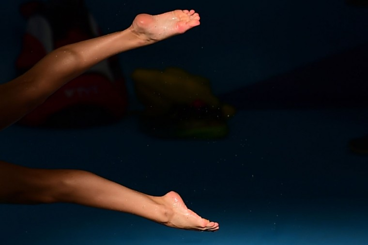 Close up on the legs of an unidentified athlete before the start of the swimming afternoon session at the 2015 FINA World Championships in Kazan on August 5, 2015. (AFP Photo/Christophe Simon)