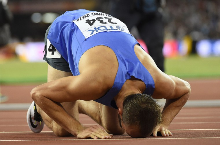 "Bronze medallist Bosnia-Herzegovina's Amel Tuka celebrates after the final of the men's 800 meters athletics event at the 2015 IAAF World Championships at the ""Bird's Nest"" National Stadium in Beijing on August 25, 2015. (OLIVIER MORIN/AFP/Getty Images)"