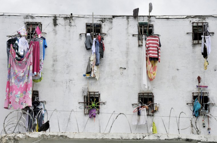 Clothes hang from the windows of La Modelo prison in Bucaramanga, Colombia, on Friday. In a prison in the mountains of Colombia, a government program gathers former guerrillas and former paramilitaries, once mortal enemies and today demobilized, in order to prove that reconciliation is possible. (GUILLERMO LEGARIA/AFP/Getty Images)