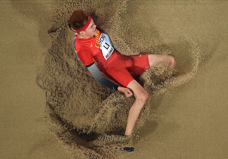 "China's Li Jinzhe competes in the final of the men's long jump athletics event at the 2015 IAAF World Championships at the ""Bird's Nest"" National Stadium in Beijing on August 25, 2015. (ANTONIN THUILLIER/AFP/Getty Images)"