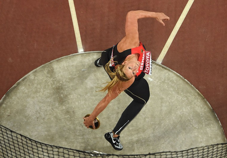 "Germany's Julia Fischer competes in the final of the women's discus throw athletics event at the 2015 IAAF World Championships at the ""Bird's Nest"" National Stadium in Beijing on August 25, 2015. (ANTONIN THUILLIER/AFP/Getty Images)"