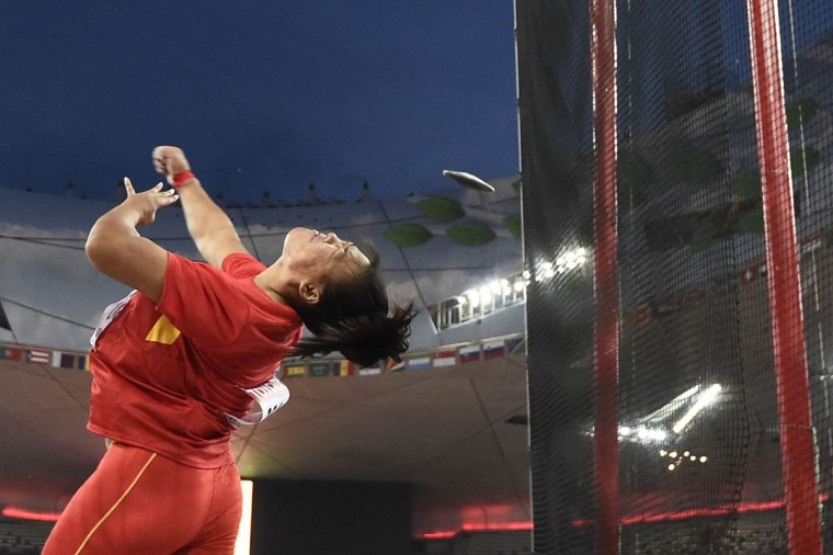 "China's Su Xinyue competes in the final of the women's discus throw athletics event at the 2015 IAAF World Championships at the ""Bird's Nest"" National Stadium in Beijing on August 25, 2015. (FRANCK FIFE/AFP/Getty Images)"