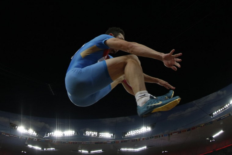 "Russia's Aleksandr Menkov competes in the final of the men's long jump athletics event at the 2015 IAAF World Championships at the ""Bird's Nest"" National Stadium in Beijing on August 25, 2015. (ADRIAN DENNIS/AFP/Getty Images)"