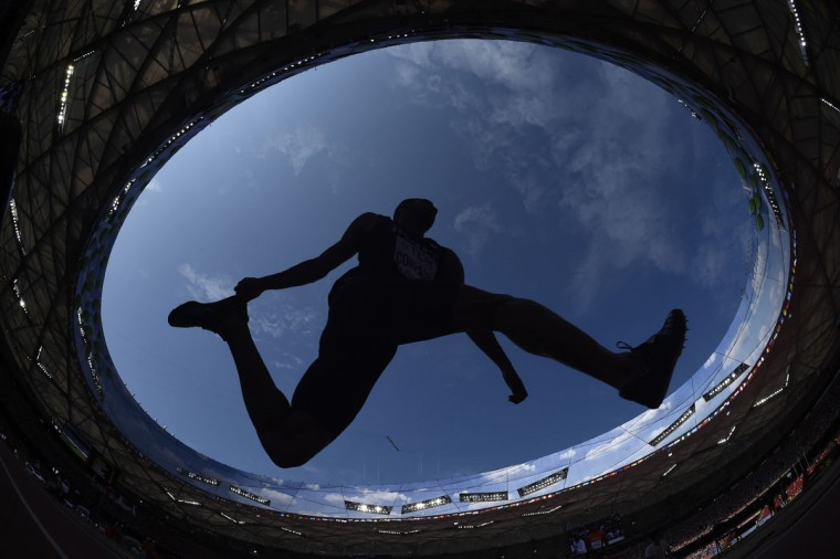 "France's Benjamin Compaore competes in the qualifying round of the men's triple jump athletics event at the 2015 IAAF World Championships at the ""Bird's Nest"" National Stadium in Beijing on August 26, 2015. (AFP Photo/Franck Fife)"