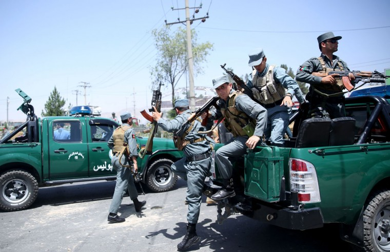 Afghan police arrive at the site of an attack at the main gate of International Hamed Karzai Airport in Kabul, Afghanistan, Monday, Aug. 10, 2015. An explosion on Monday at a busy roundabout near the entrance to Kabul's international airport that wounded at least seven people appears to have been caused by a suicide car bomb, officials said. (AP Photo/Massoud Hossaini)