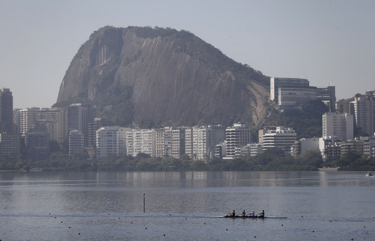 Rowers practice for the 2015 World Rowing Junior Championships on Rodrigo de Freitas lake in Rio de Janeiro, Brazil, Tuesday, Aug. 4, 2015. The head of the governing body of world rowing says he will ask for viral testing at the rowing venue for next year's Rio Olympics, and says he expects all other water sports in Rio to follow suit. The move comes after an Associated Press investigation last week showed a serious health risk to Olympic athletes who will compete at water venues around Rio that are rife with human waste and sewage. (AP Photo/Silvia Izquierdo)