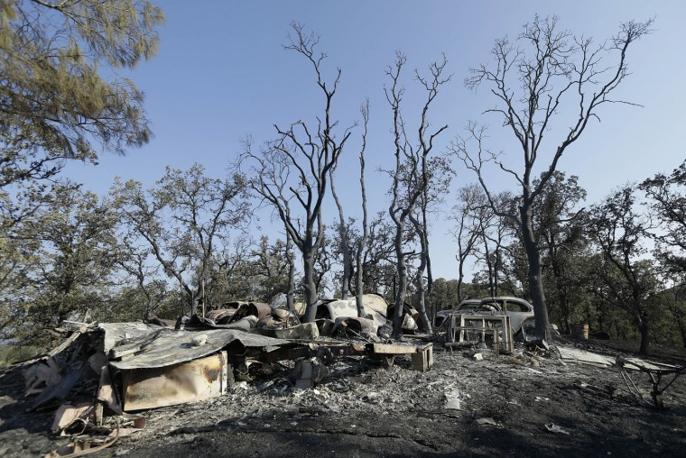 The charred remains of a property is shown near Clearlake, Calif., Thursday, Aug. 6, 2015. Crews backed by important firefighting resources are gaining ground against a massive Northern California wildfire, but it may be several days before thousands of evacuees can return home, officials said Thursday. (AP Photo/Jeff Chiu)