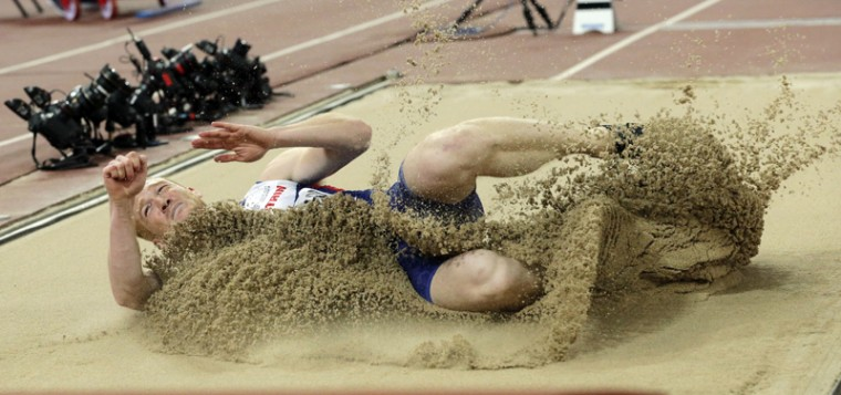 Britain's Greg Rutherford competes in the final of the men's long jump final at the World Athletics Championships at the Bird's Nest stadium in Beijing on Tuesday. (Andy Wong/AP)