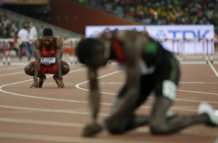 United States' Michael Tinsley, left,  looks down after finishing last in the men's 400m hurdles final at the World Athletics Championships at the Bird's Nest stadium in Beijing, on Tuesday. Kenya's Nicholas Bett, right, won the event. (David J. Phillip/AP)