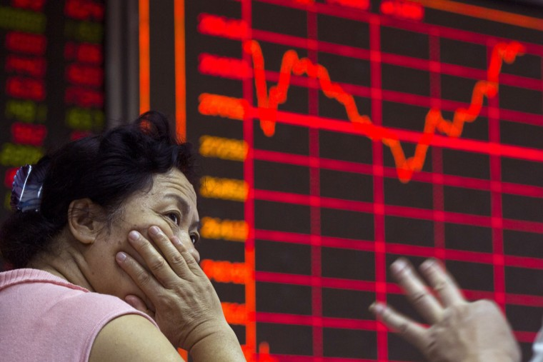 A Chinese investor monitors stock prices at a brokerage in Beijing on Wednesday, Aug. 26, 2015. Asian stocks were mixed Wednesday and Shanghai's index fell despite Beijing's decision to cut a key interest rate to help stabilize gyrating financial markets and counter short liquidity.(AP Photo/Ng Han Guan)