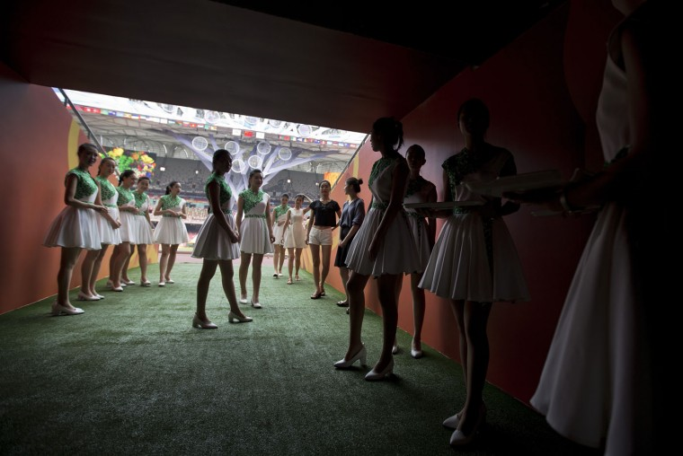 Attendants prepare to walk into the iconic Bird's Nest National Stadium during a rehearsal of medal presentation ceremonies for the upcoming 15th IAAF Athletics World Championships in Beijing Tuesday, Aug. 18, 2015. The sport event will be held in Beijing from August 22 to 30. (AP Photo/Andy Wong)