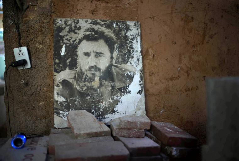 A black and white image of Fidel Castro is propped up against a wall in an apartment building undergoing renovations in Old Havana, Cuba, Thursday, Aug. 13, 2015. Castro marked his 89th birthday Thursday, with a newspaper column repeating assertions that the U.S. owes socialist Cuba ìnumerous millions of dollarsî for damages caused by a decades-long embargo. (AP Photo/Ramon Espinosa)