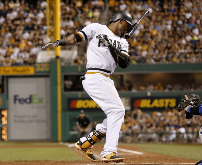 Pittsburgh Pirates' Starling Marte loses his bat as he is hit by a pitch by Los Angeles Dodgers relief pitcher Juan Nicasio in the sixth inning of a baseball game, Sunday, Aug. 9, 2015, in Pittsburgh. The Pirates won 13-6. (AP Photo/Keith Srakocic)