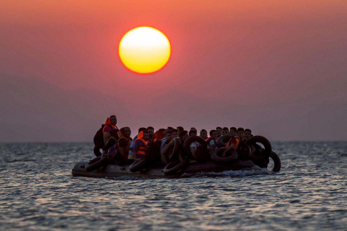 Migrants arrive in Greece, strike in Ecuador, PGA Championship | August 13