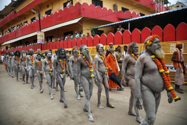 Naga sadhus, or naked Hindu holy men participate in a procession during Kumbh Mela, or Pitcher festival, at Trimbakeshwar in Nasik, India, Wednesday, Aug. 26, 2015. Millions are expected to attend this yearís two-month festival, which began in mid-July and runs until the end of September. (AP Photo/Rajanish Kakade)