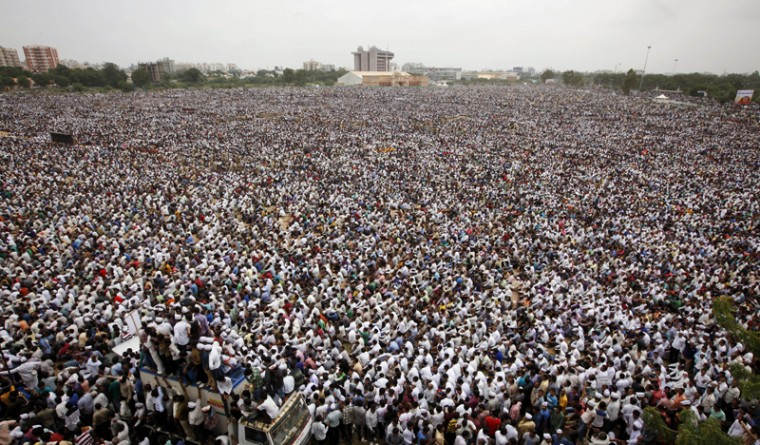 Tens of thousands of protestors from Gujarat's Patel community participate in a rally in Ahmadabad, India, on Tuesday. The members of the community from this western Indian state are demanding affirmative action for better access to education and employment. (Ajit Solanki/AP)