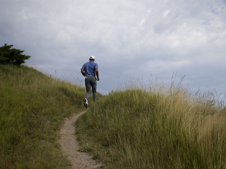 Tiger Woods walks to the 14th hole during the first round of the PGA Championship golf tournament Thursday, Aug. 13, 2015, at Whistling Straits in Haven, Wis. (AP Photo/Jae Hong)