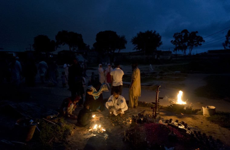 Pakistani devotees light oil lamps to get their wishes fulfilled at the Barri Imam shrine in Islamabad, Pakistan, Thursday, Aug. 20, 2015. (AP Photo/B.K. Bangash)