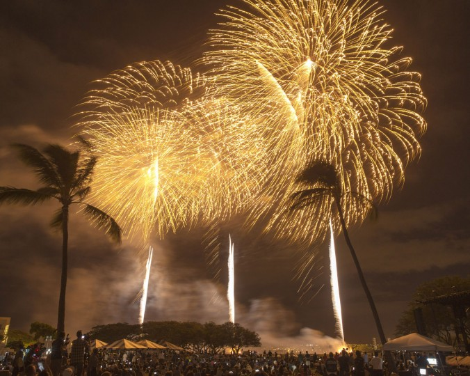 Fireworks from Nagaoka City, Japan, explode over Ford Island to celebrate the 70th anniversary of the end of World War II at Joint Base Pearl Harbor-Hickam Hawaii, Saturday, Aug. 15, 2015, in Honolulu. (AP Photo/Marco Garcia)