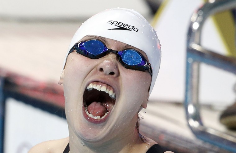 China's Fu Yuanhui celebrates after winning the gold medal in the women's 50m backstroke final at the Swimming World Championships in Kazan, Russia, Thursday, Aug. 6, 2015. (AP Photo/Sergei Grits)