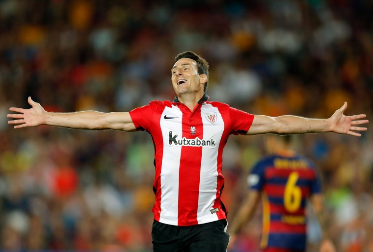 Athletic Bilbao's Aritz Aduriz celebrates after scoring his side's first goal during a second leg Spanish Super Cup soccer match between FC Barcelona and Athletic Bilbao at the Camp Nou stadium in Barcelona, Spain, Monday, Aug.17, 2015. (AP Photo/Manu Fernandez)