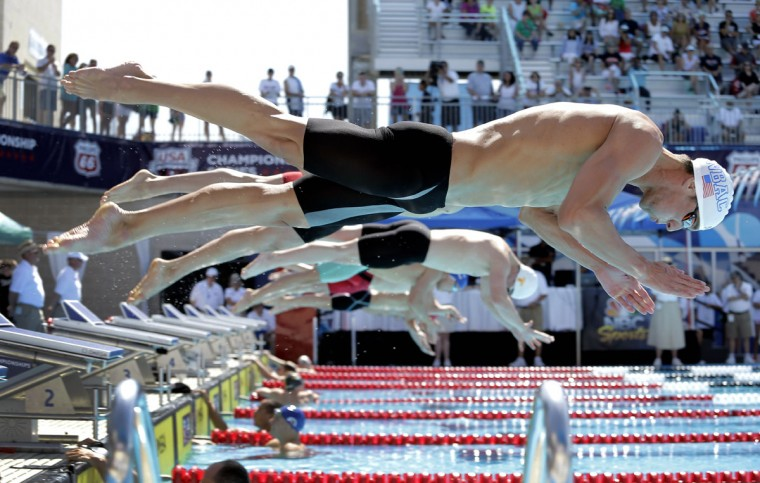 Michael Phelps, front, competes in the preliminary round of the men's 200-meter breaststroke at the the U.S. swimming nationals, Monday, Aug. 10, 2015, in San Antonio. (AP Photo/Eric Gay)