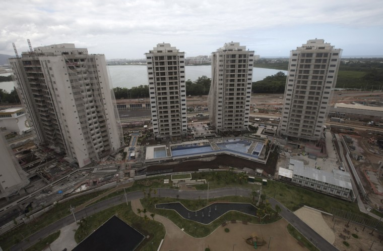 In this July 23, 2015 photo, shows the Athletes' Village under construction, in Rio de Janeiro, Brazil. The Athletes' Village is one of two high-profile legacy projects, which are primarily real estate developments anchored by luxury apartments. (AP Photo/Silvia Izquierdo)