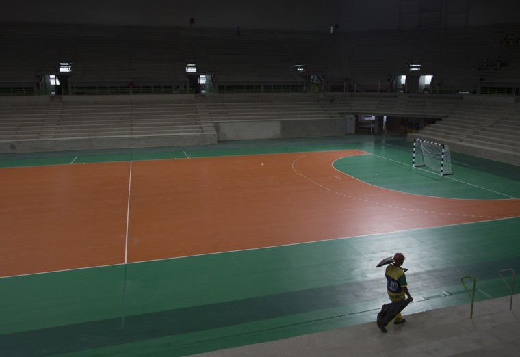 A construction worker walks inside the Olympic handball arena inside Olympic Park in Rio de Janeiro, Brazil, Wednesday, Aug. 5, 2015. Rio de Janeiro Mayor Eduardo Paes said on Wednesday all the venues for South America's first games are on track to be ready when the curtain comes up on Aug. 5 next year. (AP Photo/Leo Correa)
