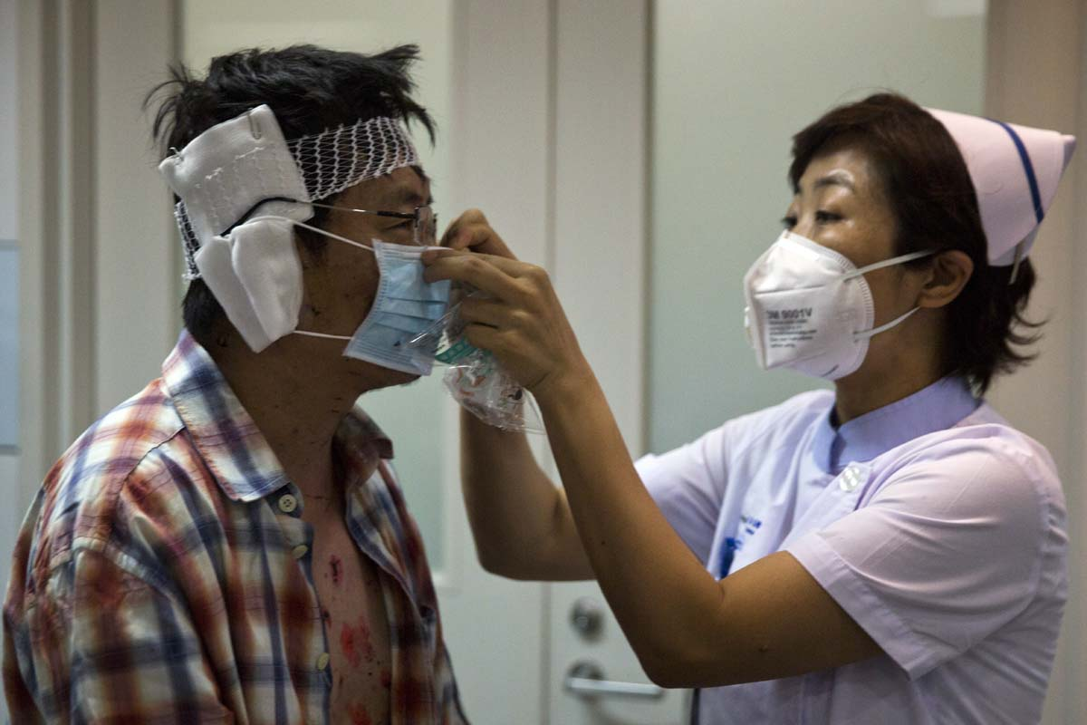 Searching for relatives, donning masks and mourning in Tianjin