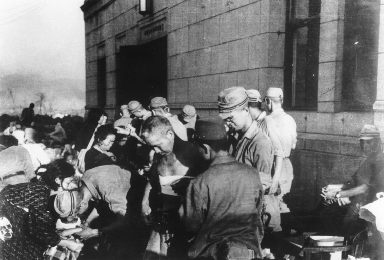 FILE - In this Aug. 6, 1945 file photo, shortly after the first atomic bomb ever used in warfare was dropped by the United States over the Japanese city of Hiroshima, survivors are seen as they receive emergency treatment by military medics in Hiroshima, Japan. The explosion instantly killed more than 60,000 people, with ten of thousands others dying later from effects of the radioactive fallout. (AP Photo)