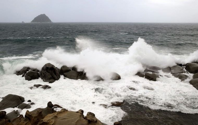 Huge waves from approaching Typhoon Soudelor break against the shoreline in Keelung, northeastern Taiwan, Friday, Aug. 7, 2015. Soudelor is expected to bring heavy rains and strong winds to the island late Friday with winds speeds over 170 km per hour (100 mph) and gusts over 200 km per hour (120 mph) according to Taiwan's Central Weather Bureau. (AP Photo/Wally Santana)