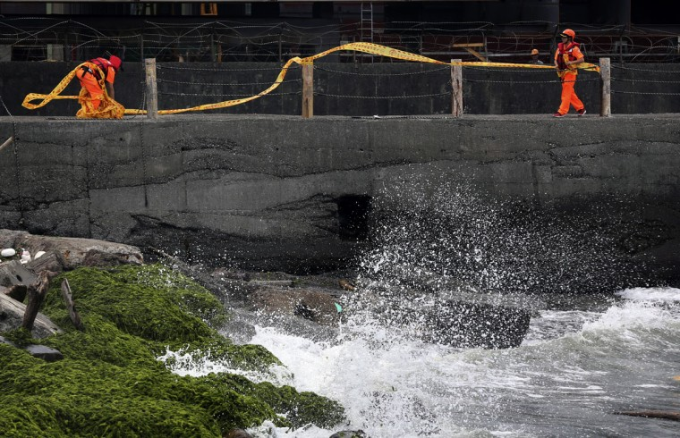 Taiwan's coast guard block off coastal walkways as Typhoon Soudelor approaches in Keelung, northeastern Taiwan, Friday, Aug. 7, 2015. Soudelor is expected to bring heavy rains and strong winds to the island late Friday with winds speeds over 170 km per hour (100 mph) and gusts over 200 km per hour (120 mph) according to Taiwan's Central Weather Bureau. (AP Photo/Wally Santana)