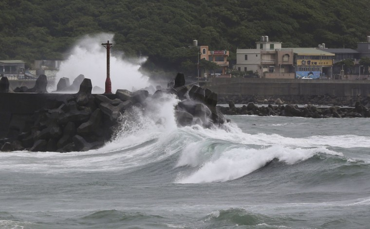 Huge waves from approaching Typhoon Soudelor crash into breakwaters off of Keelung, northeastern Taiwan, Friday, Aug. 7, 2015. Soudelor is expected to bring heavy rains and strong winds to the island late Friday with winds speeds over 170 km per hour (100 mph) and gusts over 200 km per hour (120 mph) according to Taiwan's Central Weather Bureau. (AP Photo/Wally Santana)