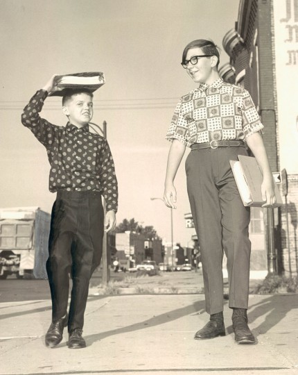 September 6, 1966 - ACADEMIC LOAD -- Alfred Emkey, 11-years old, hauls his notebook to class coolie-style. Walter Kotelevits, 12-years old, prefers the conventional grip. (Ellis J. Malashuk/Baltimore Sun)