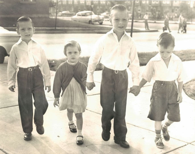 The Bridgmans are all on their way to school, from left, Thomas, 6; Rosemary, 3; John, 8; and David, 4. Rosemary and David just came along to encourage the two older boys. They are all crossing at Twenty-ninth and Barclay Streets. (Walter McCardell/Baltimore Sun, 1960)