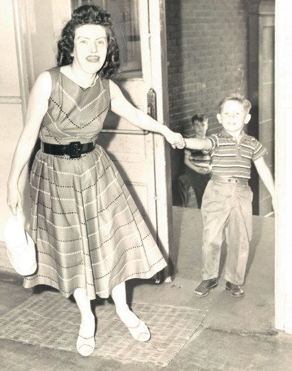 Mrs. Phyllis Rarlovich pulling her son, Edward, into school for registration. (Ellis Malashuk/Baltimore Sun, 1959)