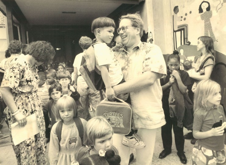 Paul Kohl smiles as he holds up son, Jiro, 5, a kindergartner, at the end of the first day of school at Mt. Washington Elementary. (Jed Kirschbaum/Baltimore Sun, 1991)