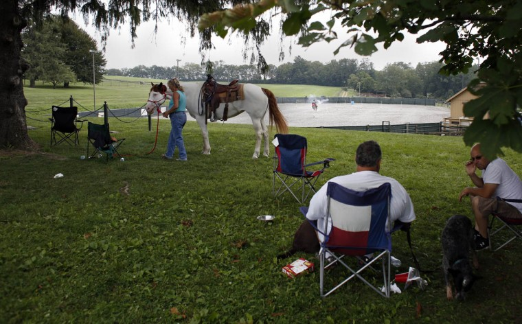 Fellow riders and enthusiasts watch cowboys and cowgirls compete at Willow Brook Farms. (Tom Brenner, Baltimore Sun)
