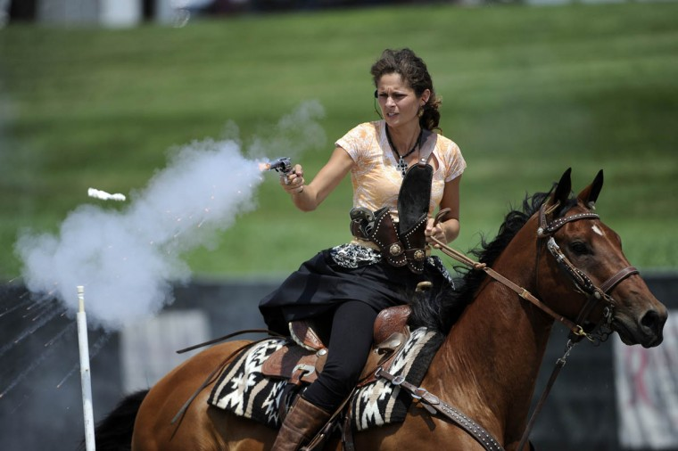 Jessica Flores, Gaithersburg, shoots a balloon during a stage during a competition at Willow Brook Farms. (Tom Brenner, Baltimore Sun)