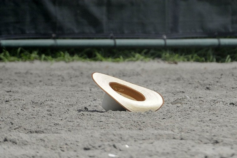 A hat lays on the ground after falling off of a cowboy's head during a competition round. (Tom Brenner / Baltimore Sun)