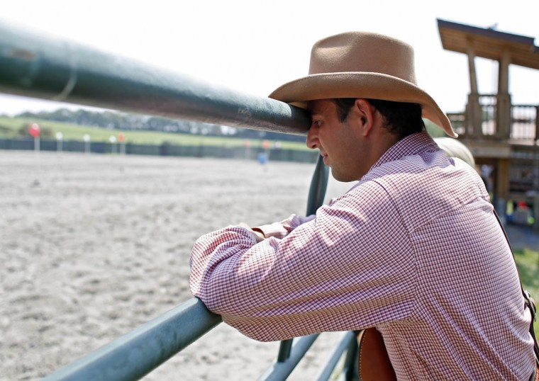 Paul Treas, Turboville, Pa., leans against a railing between competition stages at Willow Brook Farms. (Tom Brenner, Baltimore Sun)