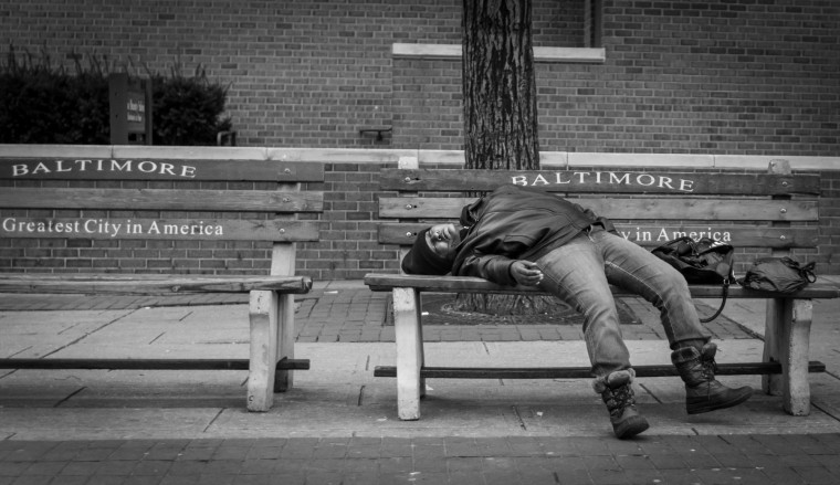 Greatest city in America - man passed out on bench