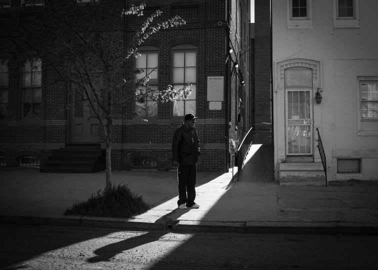 Man standing in sliver of light