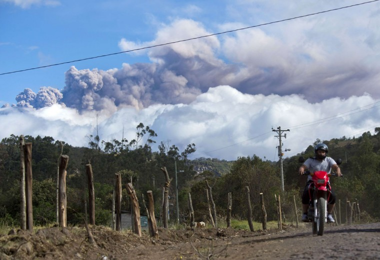 A man rides a motorcycle in Sangolqui, Ecuador with ashes spewed by the Cotopaxi volcano in the background on August 23, 2015. A dozen towns of central Ecuador, including Quito sector, suffered Saturday the ashes of the Cotopaxi volcano, which started erupting a week ago after 138 years, as crops and cattle were affected. (MARTIN BERNETTI/AFP/Getty Images)