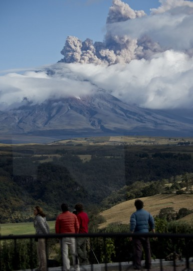View of people observing as the Cotopaxi volcano as it spews ashes from a hotel in Sangolqui, Ecuador on August 23, 2015. A dozen towns of central Ecuador, including Quito sector, suffered Saturday the ashes of the Cotopaxi volcano, which started erupting a week ago after 138 years, as crops and cattle were affected. (MARTIN BERNETTI/AFP/Getty Images)