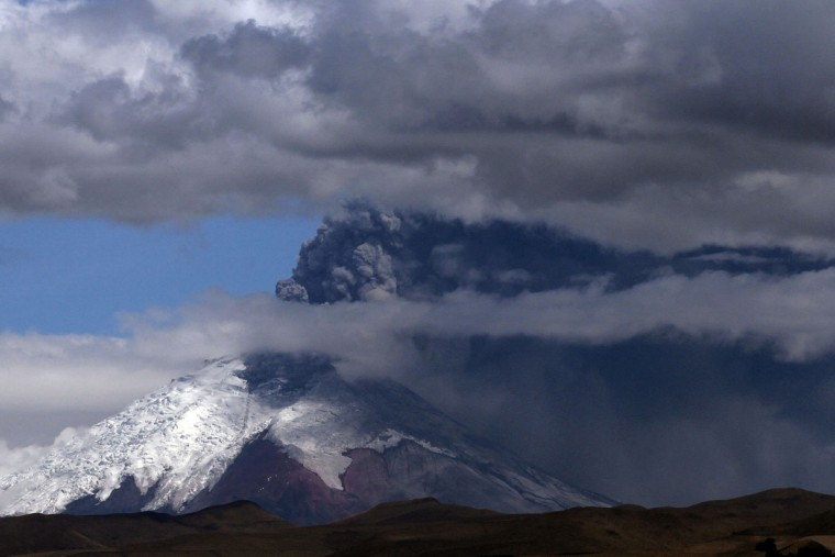 View of the Cotopaxi volcano spewing ashes from Quito, Ecuador on August 22, 2015. Ash from Ecuador's Cotopaxi volcano rained down on a dozen villages in the country's central Andean region Saturday, where agricultural output has been marred by a blanket of soot from explosions that began a week ago. (JUAN CEVALLOS/AFP/Getty Images)
