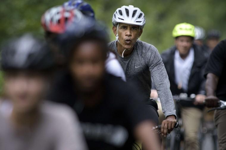 The first family, including U.S. President Barack Obama, bike ride August 22, 2015 in Vineyard Haven, Massachusetts on Martha's Vineyard. (Brendan Smialowski/AFP-Getty Images)