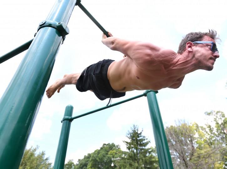 Clarke County, Va. resident Ben Curtis uses fitness equipment for lower back exercises, Saturday, Aug. 29, 2015, at Chet Hobert Park in Berryville, Va. (Jeff Taylor/The Winchester Star via AP)