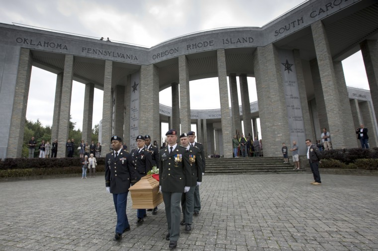 Soldiers of the U.S. and Belgian Army carry the coffin of Augusta Chiwy during a memorial service at the Mardasson Memorial in Bastogne, Belgium on Saturday, Aug. 29, 2015. Augusta Chiwy, 94, a Belgian nurse who helped save hundreds of American soldiers during the Battle of the Bulge at the end of World War II, was buried Saturday near where thousands of Allied troops fell. (Virginia Mayo/Associated Press)