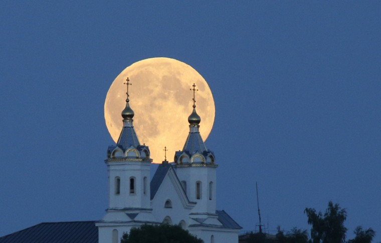 A perigee moon, also known as a super moon, rises above the Orthodox Church in the town of Novogrudok, 150 kilometers (93 miles) west of the capital Minsk, Belarus, Saturday, Aug. 29, 2015. The supermoon happens when moon is full and makes it closest approach to Earth in her orbit. (Sergei Grits/Associated Press)